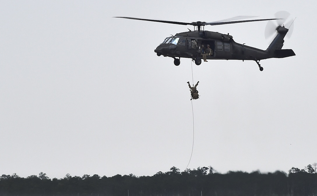 Soldiers fast rope from a UH-60 Black Hawk during Emerald Warrior 16 at Hurlburt Field, Fla., May 3, 2016. Emerald Warrior 16 is a U.S. Special Operation Command sponsored mission rehearsal exercise in which joint special operations forces train to respond to real and emerging worldwide threats. (U.S. Air Force photo/Senior Airman Logan Carlson)