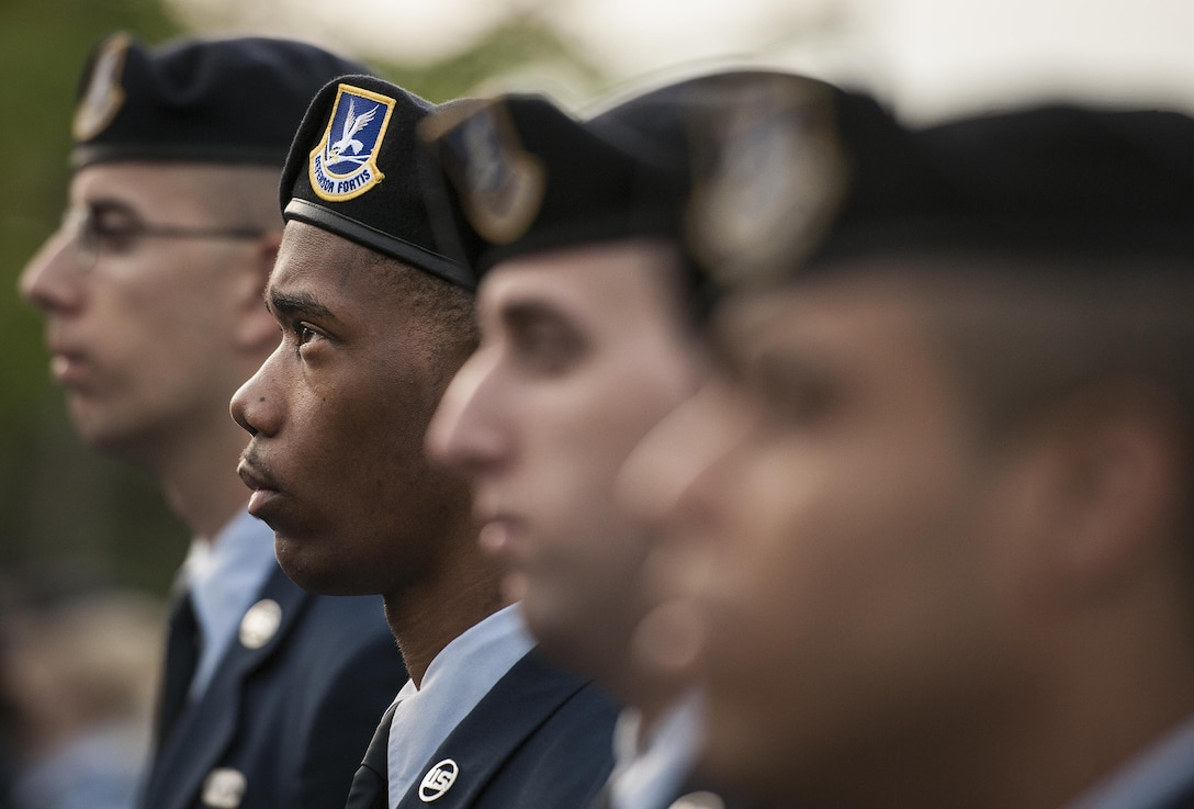 A row of 96th Security Forces Squadron Airmen stand at parade rest during the Peace Officers' Memorial Ceremony May 16, 2016, in Fort Walton Beach, Fla.  The ceremony honored fallen police officers from the previous year by reading their names aloud. Security forces Airmen from Eglin Air Force Base, Fla., and Hurlburt Field, Fla., attended and participated in the event. (U.S. Air Force photo/Samuel King Jr.)
