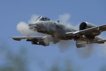 An A-10C Thunderbolt II, assigned to the 75th Fighter Squadron, performs a low-angle strafe during the Hawgsmoke competition at Barry M. Goldwater Range, Ariz., June 2, 2016. The two-day competition included team and individual scoring of strafing, high-altitude dive-bombing, Maverick missile precision and team tactics. (U.S. Air Force photo/Senior Airman Chris Drzazgowski)