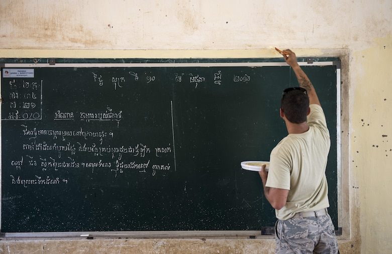 Staff Sgt. Shane Harding, a 647th Civil Engineer Squadron structures craftsman, paints a classroom during Pacific Angel 16-2, June 12, 2016, at Wat Steung Primary School in Kampot, Cambodia. The U.S. developed Pacific Angel to enhance relations and interoperability with other countries in the Indo-Asia-Pacific region. Additionally, the mission gives the U.S. an opportunity to support the efforts of other governments in the region to provide medical, dental, optometry, and engineering assistance, and subject matter expert exchanges to host nation citizens. (U.S. Air Force photo/Senior Airman Omari Bernard)