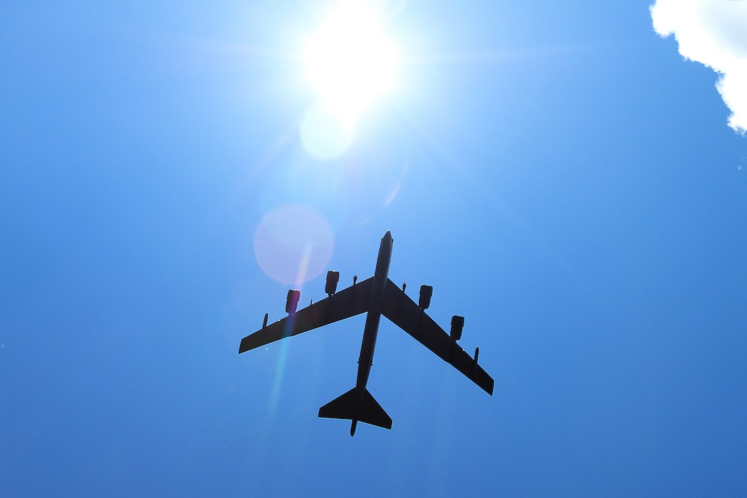 A B-52 Stratofortress flies overhead of a combined arms live fire demonstration for distinguished visitors during Saber Strike 16, June 13, at Adazi Military Base, Latvia. Saber Strike is a cooperative training exercise led by U.S. Army Europe spanning from May 27 through June 22, in locations throughout Estonia, Latvia and Lithuania, featuring 13 participating nations. (U.S. Army photo/Sgt. Paige Behringer, 10th Press Camp Headquarters)