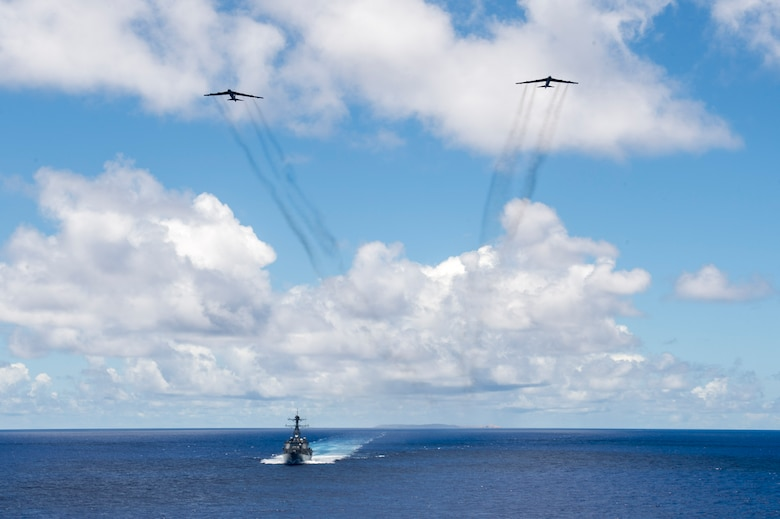 Two U.S. Air Force B-52 Stratofortress bombers assigned to the 69th Expeditionary Bomb Squadron from Andersen Air Force Base, Guam, fly overhead the U.S. Navy USS Spruance (DDG 111) guided missile destroyer following a joint-service bombing exercise in the Pacific Ocean, June 15, 2016. As part of routine continuous bomber presence operations, the bombers' presence allows U.S. forces to integrate multiple aerial platforms in the Indo-Asia-Pacific region. (U.S. Navy photo by Petty Officer 2nd Class Will Gaskill/Released)
