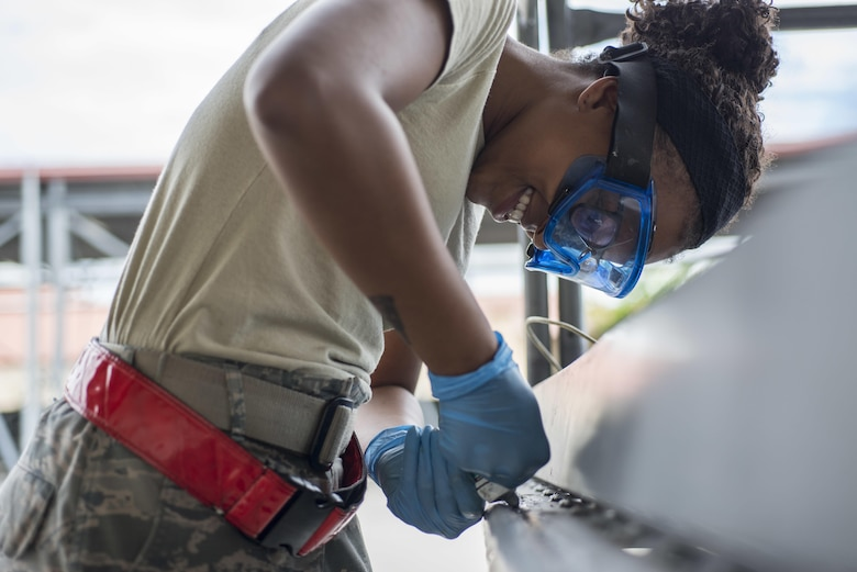 Senior Airman Dejahnay Truesdale, a 31st Maintenance Squadron aerospace ground equipment journeyman, fixes the bumper pad on a maintenance stand June 20, 2016, at Aviano Air Base, Italy. The bumper pad wraps around the edge of the stand to ensure it does not damage an aircraft when maintenance is performed. (U.S. Air Force photo/Airman 1st Class Cory W. Bush)