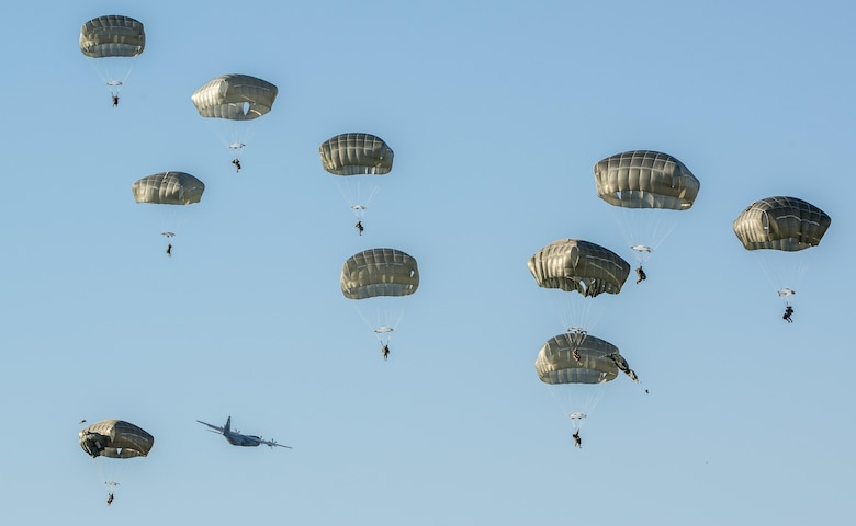 U.S. Army 173rd Airborne Brigade and German Army 1st Airborne Brigade paratroopers parachute during a joint airborne operation near Aviano Air Base, Italy, Aug. 25, 2016. The paratroopers trained on airfield clearance after jumping out of a C-130 Hercules from the 86th Airlift Wing, Ramstein Air Base, Germany after departing from Aviano AB. (U.S. Air Force photo/Airman 1st Class Cory W. Bush)