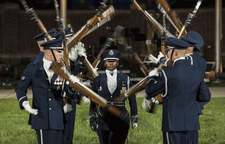 The U.S. Air Force Honor Guard Drill Team performs a rifle demonstration during the 2016 Air Force Tattoo at Joint Base Anacostia-Bolling, Washington, D.C., Sept. 22, 2016. In addition to the team's performance, the event consisted of U.S. Air Force Band routines, aircraft flyovers and heritage speeches. (U.S. Air Force photo/Senior Airman Jordyn Fetter)