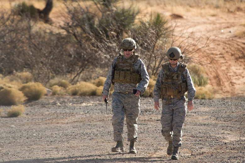 Master Sgt. Rob Shuman, the 49th Civil Engineer Squadron explosive ordnance disposal quality assurance manager, and Staff Sgt. Jacque Risley, a 49th Civil Engineer Squadron EOD technician, walk back to the safe area after investigating a potential unexploded ordnance, Jan. 6, 2017 at Holloman Air Force Base, N.M. Holloman's EOD unit was alerted by the U.S. Border Patrol about the potential UXO. (U.S. Air Force photo by Tech. Sgt. Amanda Junk)