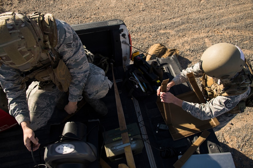 Senior Airman Matt Maurer (left), and Staff Sgt. Jacque Risley, both 49th Civil Engineer Squadron explosive ordnance disposal technicians, assemble an explosive device X-ray machine during an EOD operation Jan. 6, 2017 at Holloman Air Force Base, N.M. Holloman's EOD unit was alerted by the U.S. Border Patrol about the potential unexploded ordnance. (U.S. Air Force photo by Tech. Sgt. Amanda Junk)