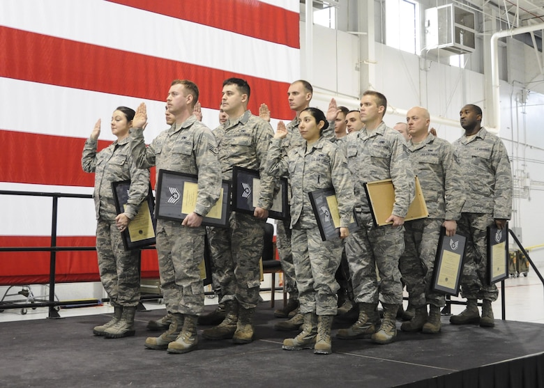 Inductees with the 442d Maintenance Group recite the non-commissioned officer creed during the NCO and Senior NCO induction ceremony at Whiteman Air Force Base, Missouri, Jan. 7, 2017. The ceremony is a tradition to congratulate Airmen in their new position while reminding SNCOs how far they've come and inspiring NCOs to continue developing their leadership abilities. (U.S. Air Force photo/Senior Airman Missy Sterling)