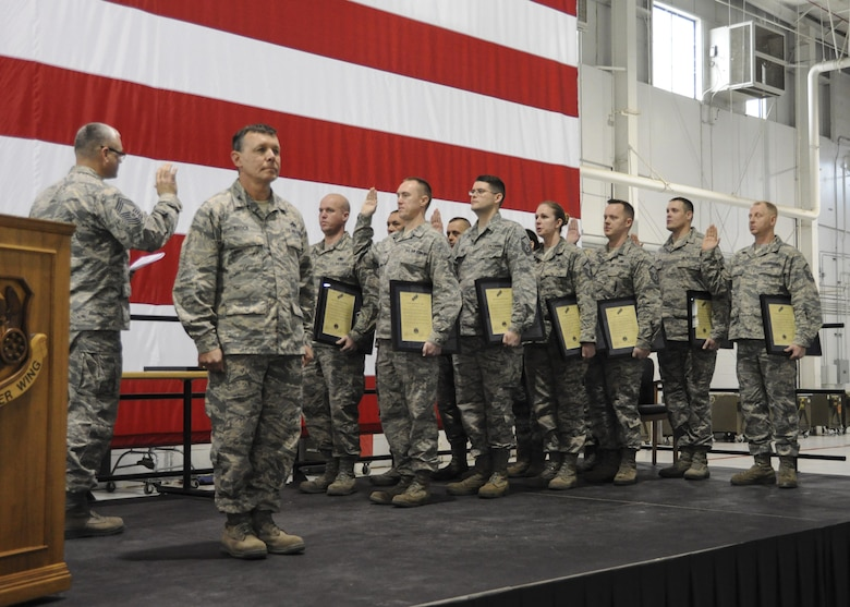 Inductees with the 442d Maintenance Group recite the senior non-commissioned officer creed during the NCO and Senior NCO induction ceremony at Whiteman Air Force Base, Missouri, Jan. 7, 2017. The ceremony is a tradition to congratulate Airmen in their new position while reminding SNCOs how far they've come and inspiring NCOs to continue developing their leadership abilities. (U.S. Air Force photo/Senior Airman Missy Sterling)