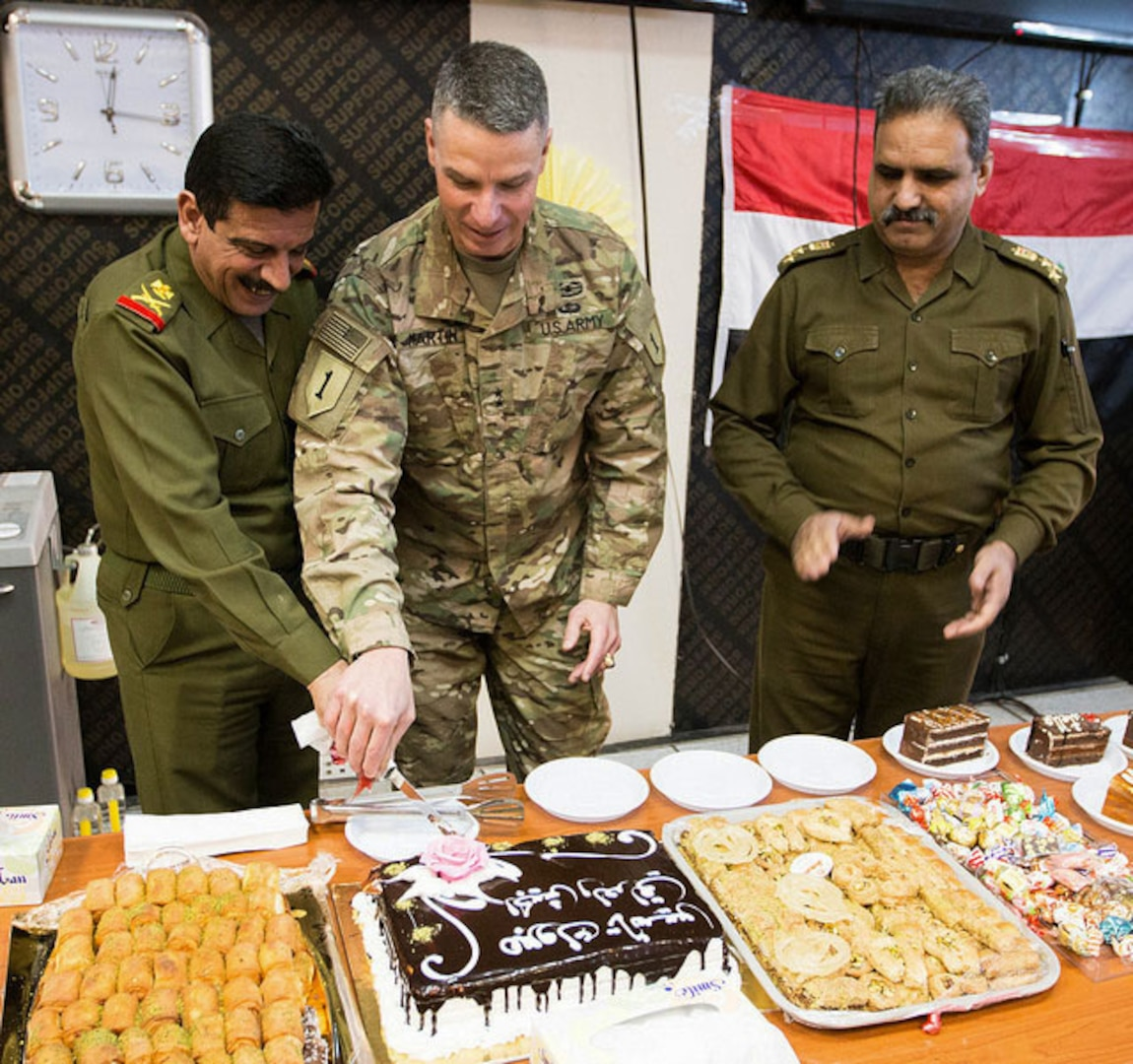 Maj. Gen. Joseph Martin, commanding general, Combined Joint Forces Land Component Command – Operation Inherent Resolve, cuts the Iraqi Armed Forces Day cake with Maj. Gen. Ahmed Abid Al-Nak Said, director, Combined Joint Operation Center – Baghdad, during a celebration Jan. 6, on Union III, Baghdad, Iraq. Iraqi Armed Forces Day commemorates the activation of the Iraqi Army on Jan. 6, 1921. (Photo by U.S. Army Spc. Derrik Tribbey)