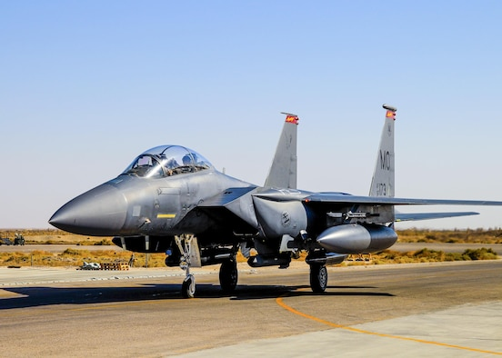 """An F-15E Strike Eagle, assigned to the 366th Fighter Wing, taxis on a runway at an undisclosed location in Southwest Asia, October 5th, 2016. Previous models of the F-15 are assigned air-to-air roles; the """"E"""" model has the capability to fight its way to a target over long ranges, destroy enemy ground positions and fight its way out. (Courtesy Photo)"""
