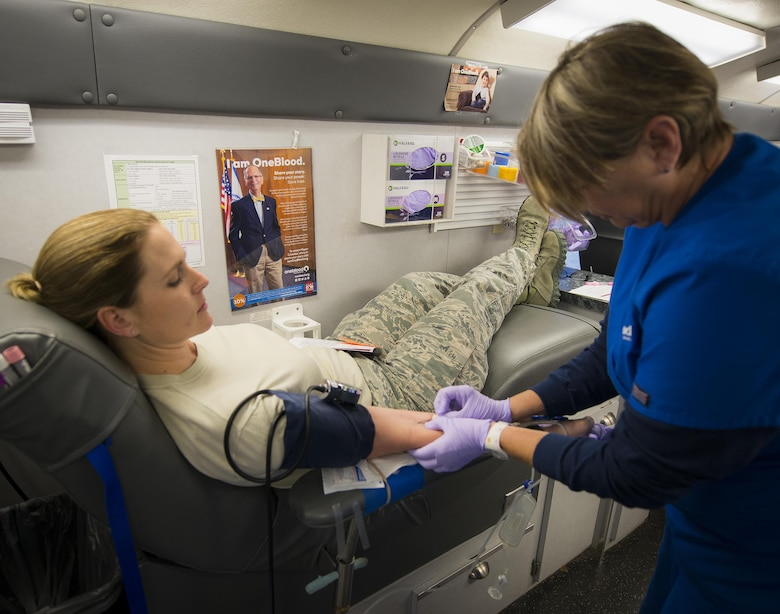Master Sgt. Christina Anger, 919th Special Operations Maintenance Group, gets the needle to begin donating blood Jan. 8 at Duke Field, Fla.  The Human Resource Development Council-sponsored blood drive was the group's first event of the new year.  (U.S. Air Force photo/Tech. Sgt. Sam King)