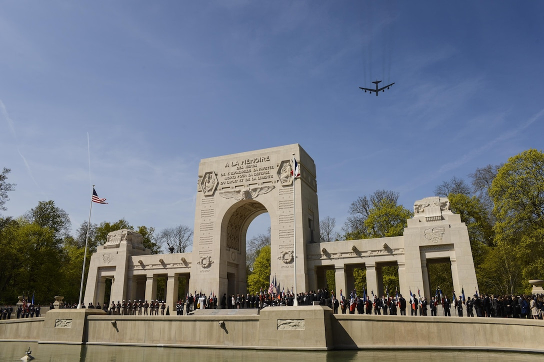 A B-52 Stratofortress flies over the Lafayette Escadrille Memorial in Marnes-la-Coquette, France, April 20, 2016, during a ceremony honoring the 268 Americans who joined the French air force before the U.S. officially engaged in World War I. In addition to the B-52, four F-22 Raptors, four French Mirage 2000Ns and a WWI-era Steerman PT-17 biplane performed flyovers during the ceremony commemorating the 100th anniversary of the Layfette Escadrille's formation. (U.S. Air Force photo/Tech. Sgt. Joshua DeMotts)