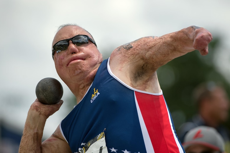 U.S. Air Force Master Sgt. Israel Del Toro throws a shotput during the 2016 Invictus Games slogan in Orlando, Fla. May 10, 2016. (DoD News photo by EJ Hersom)