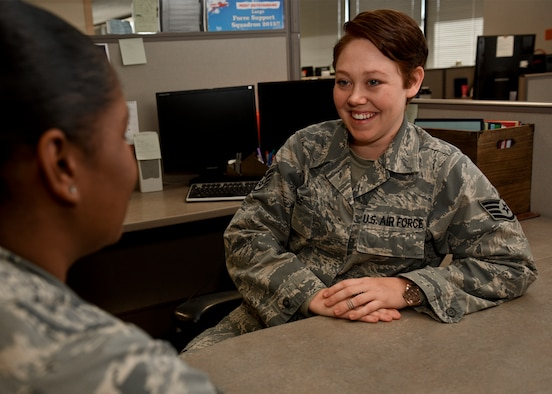 PETERSON AIR FORCE BASE, Colo. – Staff Sgt. Jacquelyn Combs, 21st Force Support Squadron NCO in charge of customer support at the Military Personnel Section, jokes with a coworker at the Military Personnel Section on Peterson Air Force Base, Colo., Nov. 14, 2016. Combs was diagnosed with Crohn's disease while at her first base and diagnosed with cancer at her second base, but didn't let either of them stop her from doing her best. (U.S. Air Force photo by Senior Airman Rose Gudex)