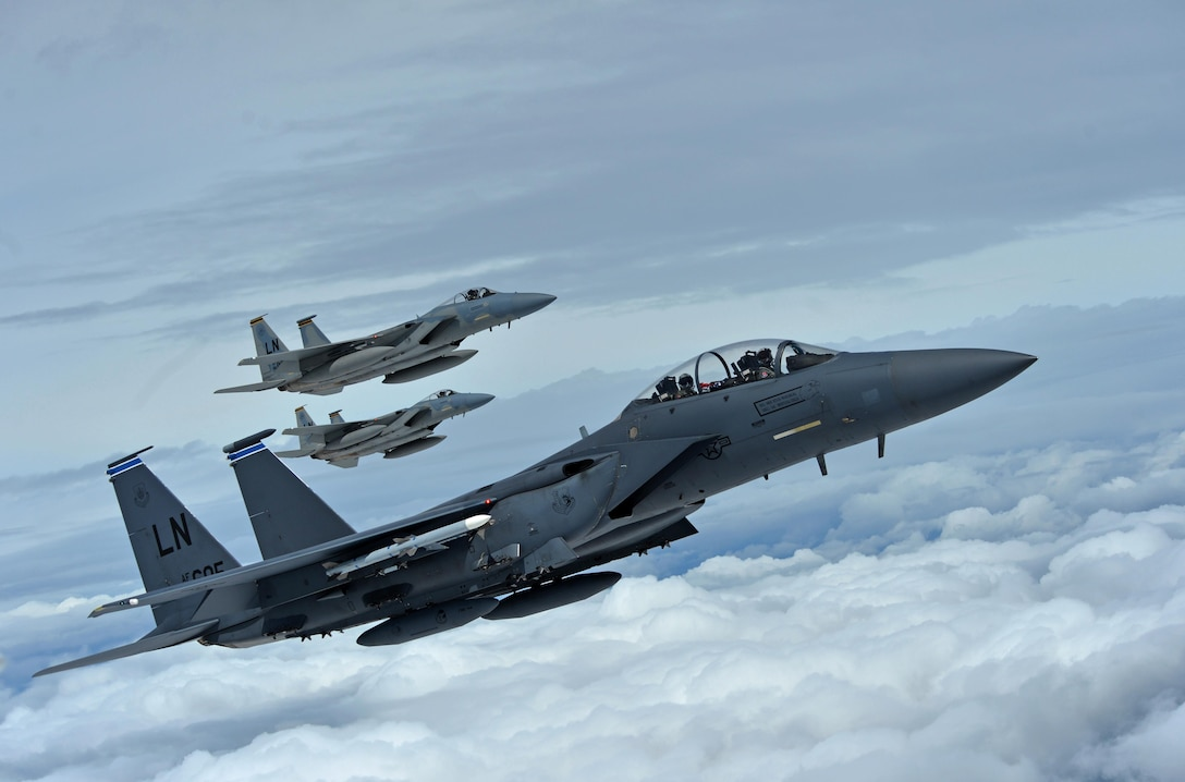 A formation of F-15C Eagles assigned to the 493rd Fighter Squadron, and an F-15E Strike Eagle assigned to the 492nd Fighter Squadron, fly over Gloucestershire, England, to attend the upcoming Royal International Air Tattoo airshow held at Royal Air Force Fairford, July 7, 2016. The Royal Air Force Lakenheath aircraft were on public display, along with many other military aircraft from around the U.K., to provide an opportunity for U.S. and military allies to showcase their capabilities. (U.S. Air Force photo/Senior Airman Erin Trower)