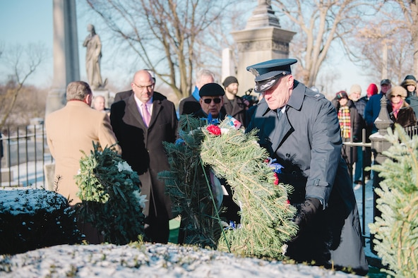 Col. Gary R. Charlton, vice commander of the 107th Airlift Wing, Niagara Falls Air Reserve Station, presents a wreath at the grave of President Millard Fillmore, on behalf of President Barack Obama, Forest Lawn Cemetery, Buffalo, N.Y., Jan. 6, 2017. The ceremony, which is held by the University at Buffalo, a school which Fillmore was one of the founders, commemorates the former president's birthday. (U.S. Air Force Photo by Staff Sgt. Ryan Campbell)