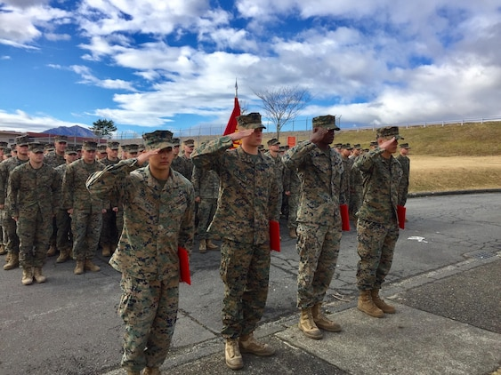 Four U.S. Marines receive Navy Achievement Medals during a battalion formation Jan. 9, 2017, aboard Combined Arms Training Center Camp Fuji, Japan, for their instinctive response when a vehicle with five passengers fell from the fifth story of a parking garage in Yokosuka, a city in the Greater Tokyo Area, Dec. 31, 2016. Once the Marines arrived on scene, the group flipped the car in order to remove the passengers prior to Japanese Emergency Medical Services arriving. The Marines are riflemen assigned to 3rd Battalion, 1st Marine Regiment and forward-deployed to 3rd Marine Division, III Marine Expeditionary Force, based in Okinawa, Japan. U.S. Marines pictured left to right: Lance Cpl. Manaure Arellano, Lance Cpl. James Flores, Lance Cpl. Raheem Gilliam and Pfc. Jacob Boerner. (U.S. Marine Corps photo by Sgt. Maj. Damien Coan)