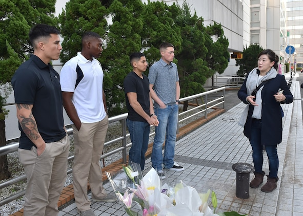 A reporter with Kyodo News interviews U.S. Marines and Sailors in downtown Yokosuka, Japan, Jan. 7, 2016. Four U.S. Marines and two Sailors instinctively responded alongside local residents when a vehicle with five passengers fell from the fifth story of a parking garage in Yokosuka, Dec. 31, 2016. Once the Marines arrived on scene, the group collectively flipped the car in order to remove the passengers prior to Japanese Emergency Medical Services arriving. The Marines are assigned to 3rd Battalion, 1st Marine Regiment and forward deployed to 3rd Marine Division, III Marine Expeditionary Force based in Okinawa, Japan. The Sailors are assigned to Commander Fleet Activities Yokosuka. U.S. Marines pictured left to right at the memorial sight of the accident: Pfc. Jacob Boerner, Lance Cpl. Raheem Gilliam, Lance Cpl. Manaure Arellano and Lance Cpl. James Flores. (U.S. Navy photo by Petty Officer 2nd Class Richard Gourley)