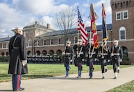 U.S. Marines and Sailors present colors during the Secretary of the Navy farewell parade at Marine Barracks Washington, Washington, D.C., Jan. 6, 2017. The parade was held in honor of the Honorable Raymond E. Mabus who was the longest serving Secretary of the Navy sinceWorld War I.