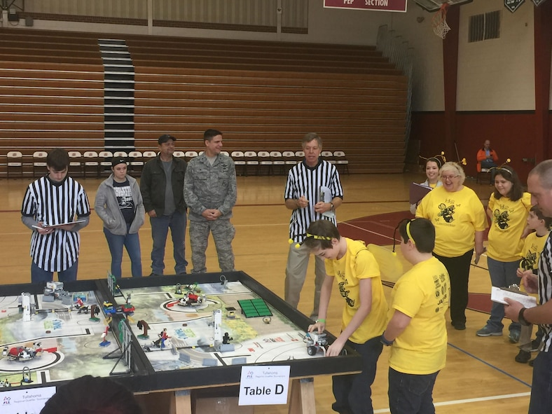 Sean O'Gorman and Jamison Norton (left to right at table), on the LegoTronics team from East Middle School, Tullahoma, prepare their team's robot to complete a FIRST® LEGO® League (FLL) mission. Twenty-seven teams gathered at Tullahoma High School Dec. 17, 2016, to compete in the FLL Regional Qualifier Tournament.  (U.S. Air Force photo/Holly Peterson)