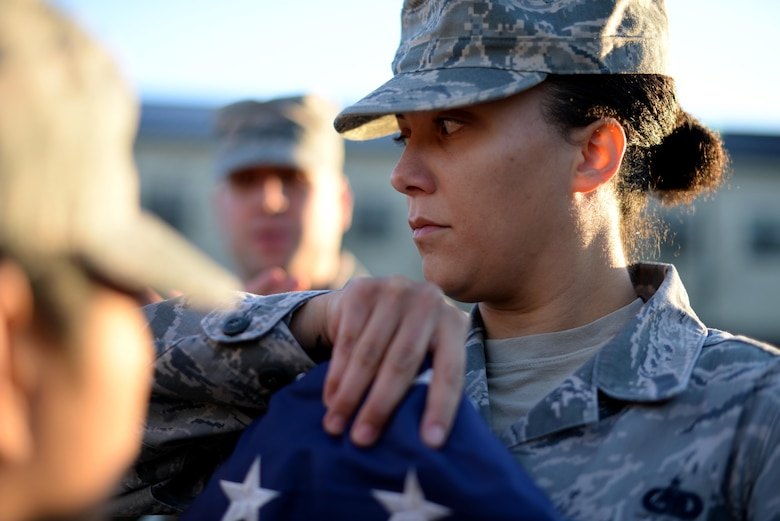 Staff Sgt. Latosha Enoch, 81st Training Support Squadron Military Training Leader Course student, folds a U.S. flag during a retreat practice at the Levitow Training Support Facility, Dec. 15, 2016, on Keesler Air Force Base, Miss. NCOs attending the MTL Course were given refresher training on drill and ceremony to ensure proficiency before they begin leading non-prior service Airmen upon graduation. (U.S. Air Force photo by Senior Airman Duncan McElroy)