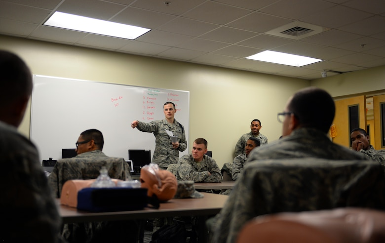 Staff Sgt. Turner Phillips, 81st Training Support Squadron Military Training Leader Course instructor, assigns roles to non-prior service Airmen for a counseling exercise, Dec. 19, 2016, on Keesler Air Force Base, Miss. MTL Course instructors evaluate the students on their ability to counsel Airmen awaiting training, who presented different issues they may encounter in the training environment. (U.S. Air Force photo by Senior Airman Duncan McElroy)