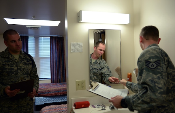 Staff Sgt. Christian Ortiz Morales, 81st Training Support Squadron Military Training Leader Course student, performs a room inspection, Dec. 21, 2016, on Keesler Air Force Base, Miss. MTL Course instructors evaluated students in a variety of different areas during the four-week course, including drill and ceremony, dress and appearance, mentorship, counseling and physical training. (U.S. Air Force by Senior Airman Duncan McElroy)