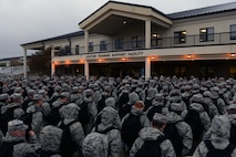 Non-prior service Airmen stand in formation prior to an 81st Training Support Squadron Military Training Leader Course graduation ceremony at the Levitow Training Support Facility, Dec. 22, 2016, on Keesler Air force Base, Miss. Twelve NCOs received their blue aiguillettes and will be assigned to different training groups within 2nd Air Force to mentor, train and lead non-prior service Airmen. (U.S. Air Force photo by Senior Airman Duncan McElroy)