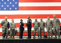 U.S. Air Force Chief Master Sgt. Kellie Askew, 442d Aircraft Maintenance Squadron deputy superintendent, joins the rank of chief during his promotion ceremony at Whiteman Air Force Base, Missouri, Jan. 7, 2017. Askew became an Air Reserve Technician for the 442d Maintenance Group in 1997. (U.S. Air Force photo/Senior Airman Missy Sterling)