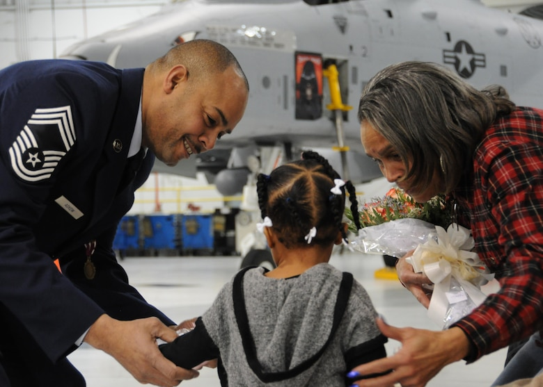 U.S. Air Force Chief Master Sgt. Kellie Askew, 442d Aircraft Maintenance Squadron deputy superintendent, presents his mother and granddaughter flowers during his promotion ceremony at Whiteman Air Force Base, Missouri, Jan. 7, 2017. Askew left active-duty in 1996 and joined the Air Force Reserve unit at Hill AFB, Utah. (U.S. Air Force photo/Senior Airman Missy Sterling)