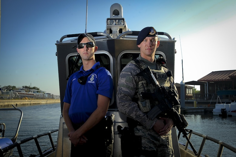 Senior Airmen Zade Becker, left, a marine patrolman assigned to the 6th Security Forces Squadron (SFS), and his brother Austin Becker, right, an emergency services team operator assigned to the 6th SFS, pause for a photo at MacDill Air Force Base, Fla., Dec. 14, 2016. The Becker brothers are currently stationed together at MacDill and defend the base as security forces members. (U.S. Air Force photo by Airman 1st Class by Mariette Adams)