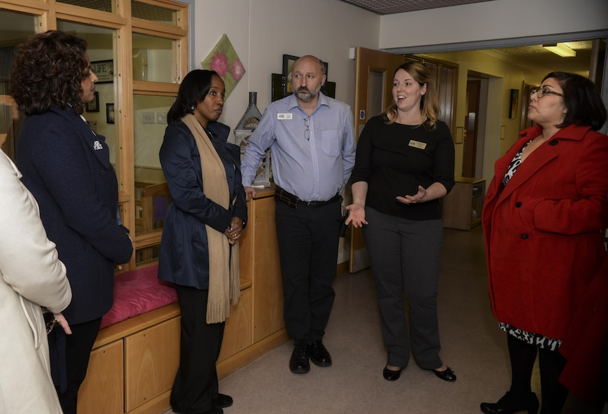 Amy Clark, left, spouse of U.S. Air Force Lt. Gen. Richard Clark, 3rd Air Force commander; and Yolanda Easton, second from left, spouse of U.S. Air Force Chief Master Sgt. Phillip Easton, 3rd Air Force command chief, visit the child development center during a tour Jan. 5, 2016, on RAF Mildenhall, England. The CDC provides quality childcare for children, ages 6 weeks to 5 years in an environment that celebrates each child's individual successes through social, cognitive, affective, physical, language and creative development. (U.S. Air Force photo by Airman 1st Class Tenley Long)