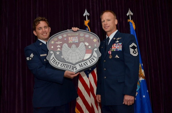 Members of the 308th Rescue Squadron presented Senior Master Sgt. Jon Grant, pararescue superintendent, 920th Operations Group, with a special shadow box for his retirement from the Air Force Reserve January 7, 2017, after 27-year Air Force career as a pararescueman. During the ceremony at Patrick Air Force Base, comrades and commanders filled the room to honor him and his family for their longstanding service to country. (U.S. Air Force photo/Senior Airman Brandon Kalloo Sanes)