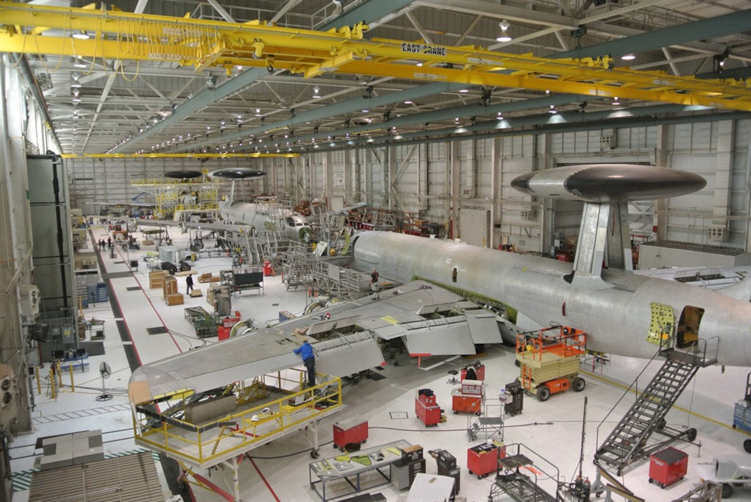 Workers at Tinker Air Force Base, Oklahoma, install critical 40/45 upgrades to E-3 AWACS aircraft during programmed depot maintenance at the Oklahoma City Air Logistics Complex. Defense Logistics Agency Energy recently awarded an energy saving performance contract to implement energy conservation measures at the OC-ALC.