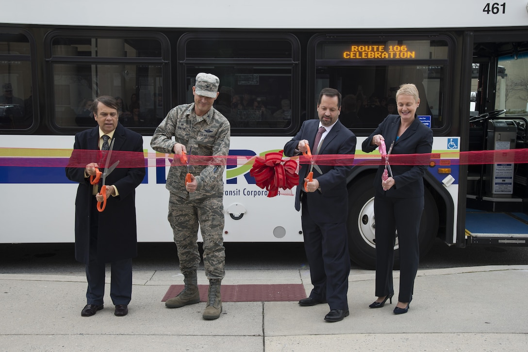 From left, Mayor of Dover Robin Christiansen; Col. Ethan Griffin, 436th Airlift Wing commander; John Sisson, Delaware Transit Corporation CEO; and Delaware Secretary of Transportation Jennifer Cohan prepare to cut a ribbon Jan. 5, 2016, outside Eagle's Rest Inn on Dover Air Force Base, Del. The ceremony commemorated the grand opening of two new bus stops on base, which will better connect Airmen with the off-base community. (U.S. Air Force photo by Senior Airman Aaron J. Jenne)