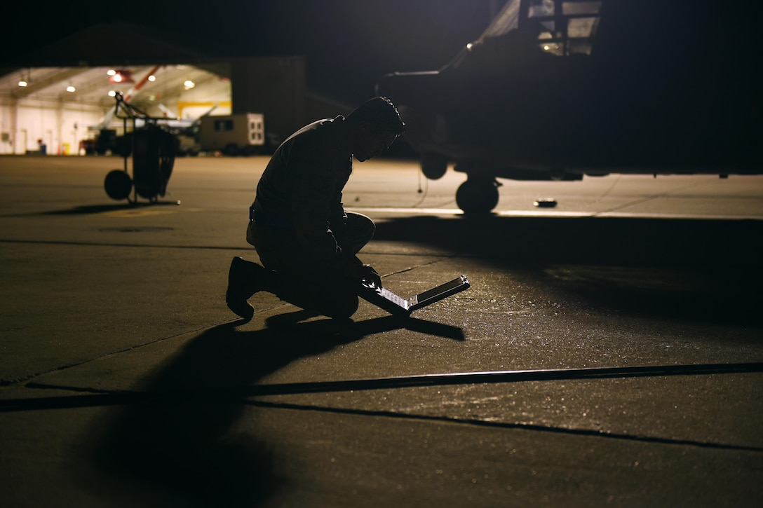 An Air Commando with the 27th Special Operations Maintenance Squadron's Aircraft Structural Maintenance shop consults a technical order November 16, 2016 at Cannon Air Force Base, N.M. Aircraft structural maintainers are part of a large group of Cannon Air Commandos who work through the night to keep aircraft flying. (U.S. Air Force Photo by Senior Airman Shelby Kay-Fantozzi/released)