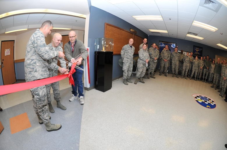 U.S. Air Force Lt. Col. Kenneth Stremmel, 315th Training Squadron Commander, Staff Sgt. Brittin Davis, 315th TRS instructor and John Blastick, 315th TRS facility manager, cut the ribbon officially opening the Heritage Hall in Di Tommaso Hall on Goodfellow Air Force Base, Texas, Jan. 6, 2017. Members worked together to create the hall to honor the units' past. (U.S. Air Force photo by Staff Sgt. Laura R. McFarlane/Released)