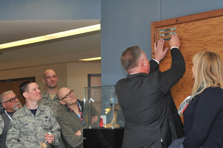 U.S. Air Force retired Lt. Col. Devin Swallow, former 315th Training Squadron Commander, places his nametag on the wall in Heritage Hall in Di Tommaso Hall on Goodfellow Air Force Base, Texas, Jan. 6, 2017. Departing personnel will place their nametags on the board as part of the heritage of the unit. (U.S. Air Force photo by Staff Sgt. Laura R. McFarlane/Released)