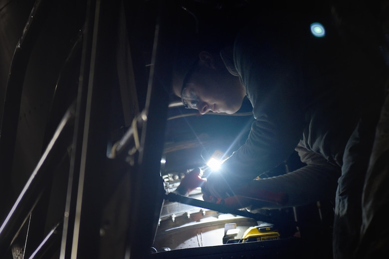 An Air Commando with the 27th Special Operations Maintenance Squadron's Aircraft Structural Maintenance shop repairs a CV-22 Osprey tilt-rotor aircraft November 16, 2016 at Cannon Air Force Base, N.M. Aircraft structural maintainers are part of a large group of Cannon Air Commandos who work through the night to keep aircraft flying. (U.S. Air Force Photo by Senior Airman Shelby Kay-Fantozzi/released)