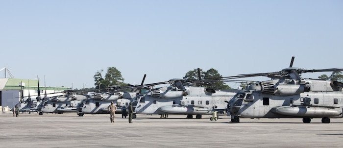 Several CH-53E Super Stallion helicopters from Marine Heavy Helicopter Squadron 772, Special Purpose Marine Air-Ground Task Force - Southern Command, standby on the flight line aboard Marine Corps Air Station New River, North Carolina, before departing for Soto Cano Air Base, Honduras, June 8, 2016. SPMAGTF-SC is a temporary deployment of Marines and sailors throughout Honduras, El Salvador, Guatemala, and Belize with a focus on building and maintaining partnership capacity with each country through shared values, challenges, and responsibility. (U.S. Marine Corps photo by Sgt. Adwin Esters/Released)
