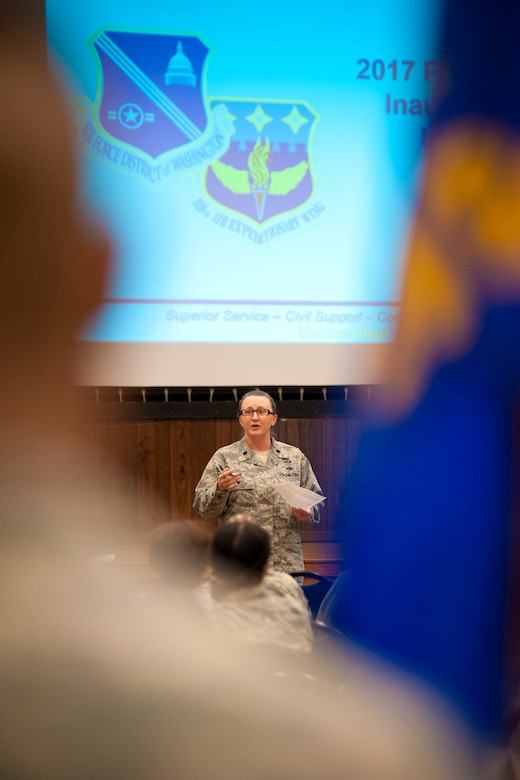 Lieutenant Col. Rebecca Fox, 459th Air Refueling Wing executive officer, conducts a training brief to Presidential Inaugural Parade volunteers in the wing auditorium on Joint Base Andrews, Maryland, Jan. 8, 2017. Nearly 90 459th ARW reservists are slated to represent the more than 69,000 members of Air Force Reserve Command in the January 20th parade. (U.S. Air Force photo/Tech. Sgt. Kat Justen)