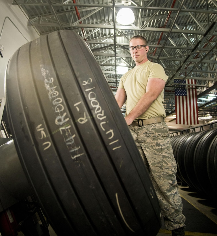Senior Airman Eric Reside, 60th Maintnenace Squadron wheel and tire team member, uses a lift to finish the buildup process for a tire Jan. 5, 2017 at Travis Air Force Base, Calif. Reside and the rest of the wheel and tire team ensures C-17 Globemaster III and C-5M Super Galaxy tires are ready to go whenever needed. (U.S. Air Force photo/Staff Sgt. Nicole Leidholm)