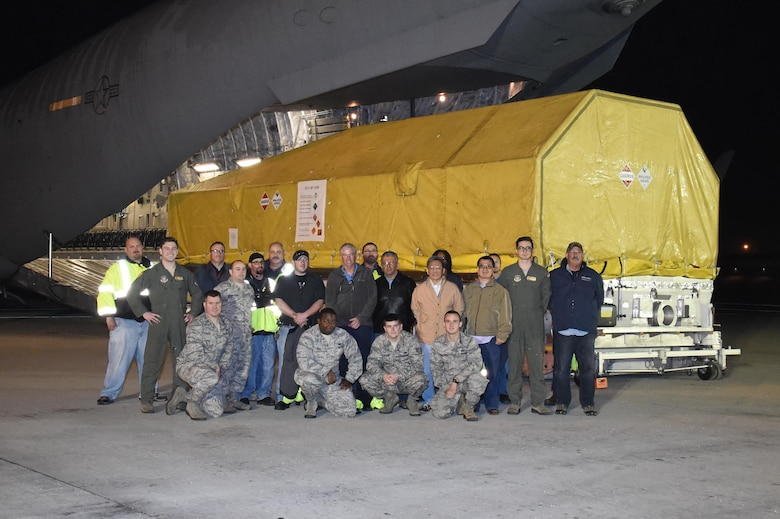 The ninth Wideband Global SATCOM (WGS-9), satellite is transported from the Boeing facility in El Segundo to LAX for delivery via an Air Force C-17 Globe Master, to Cape Canaveral Air Force Station, Florida, Jan, 9.  WGS-9 will provide additional communications capabilities to both U.S. forces and international partners after undergoing final processing, encapsulation, and transport to the launch pad.  (U. S. Air Force photo/ Joseph M. Juarez Sr.)