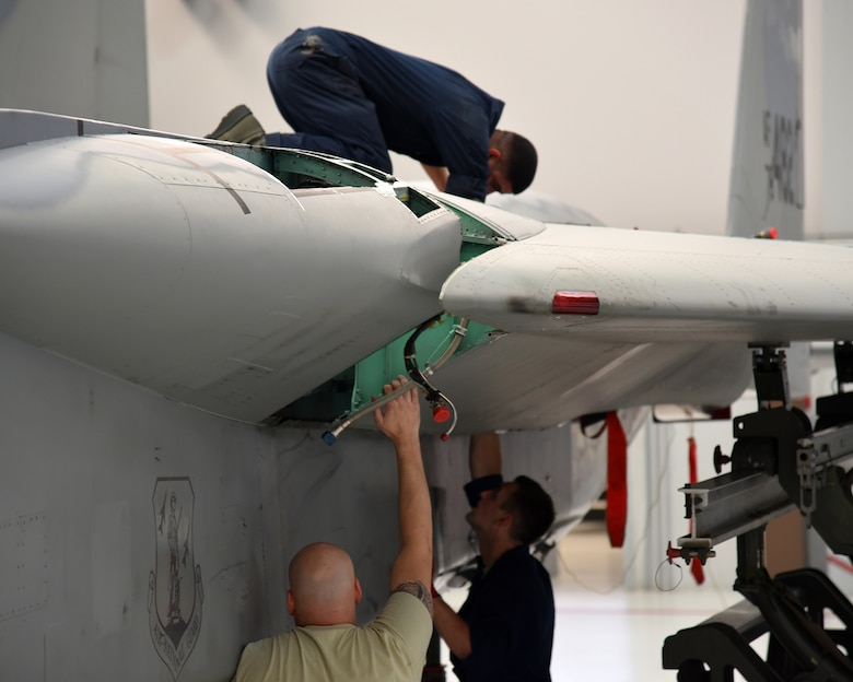 The Depot Field Team from the 402nd Aircraft Maintenance Group, Robins Air Force Base, Ga., attaches a new wing to F-15C Eagle 78-482, assigned to the 142nd Fighter Wing, Portland Air National Guard Base, Ore., Dec. 6, 2016. (U.S. Air National Guard photo by Senior Master Sgt. Shelly Davison, 142nd Fighter Wing Public Affairs)