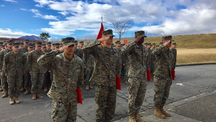 Four U.S. Marines receive Navy Achievement Medals during a battalion formation Jan. 9, 2017, aboard Combined Arms Training Center Camp Fuji, Japan, for their instinctive response when a vehicle with five passengers fell from the fifth story of a parking garage in Yokosuka, a city in the Greater Tokyo Area, Dec. 31, 2016. Once the Marines arrived on scene, the group flipped the car in order to remove the passengers prior to Japanese Emergency Medical Services arriving. The Marines are riflemen assigned to 3rd Battalion, 1st Marine Regiment and forward-deployed to 3rd Marine Division, III Marine Expeditionary Force, based in Okinawa, Japan. U.S. Marines pictured left to right: Lance Cpl. Manaure Arellano, Lance Cpl. James Flores, Lance Cpl. Raheem Gilliam and Pfc. Jacob Boerner.