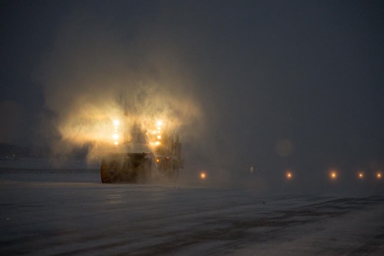 Airmen of 436th Civil Engineer Squadron remove snow from the runway during a snow storm Jan. 7, 2017, at Dover Air Force Base, Del. The Airmen operated vehicles around the clock to ensure the runway was suitable for flight operations. (U.S. Air Force photo by Mauricio Campino)