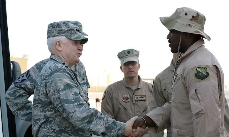 U.S. Air Force Lt. Gen. L. Scott Rice, director of the Air National Guard, shakes hands with Airmen with the 340th Expeditionary Air Refueling Squadron at Al Udeid Air Base, Qatar, Jan. 4, 2016. Rice expressed his gratitude for those serving in the deployed environment and for their continued patriotism. (U.S. Air Force photo by Senior Airman Cynthia A. Innocenti)