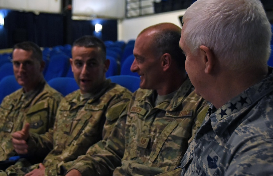 U.S. Air Force Lt. Gen. L. Scott Rice, director of the Air National Guard, converses with guardsmen before speaking at an all call at Al Udeid Air Base, Qatar, Jan. 4, 2016. During his speech, Rice explained the importance of continuing with the total force mindset. (U.S. Air Force photo by Senior Airman Cynthia A. Innocenti)
