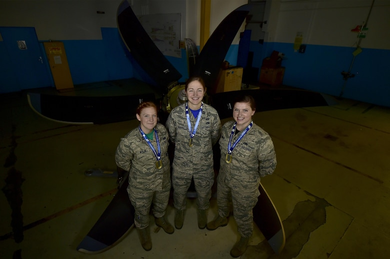 (From left) U.S. Air Force Capts. Rachel Weiler, Michelle Harrington, and 2nd Lt. Haley Janssen, all officers assigned to the 86th Maintenance Group, pose for a photo in front of a C-130J Super Hercules propeller at Ramstein Air Base, Germany, Jan. 6, 2017. The three company-grade officers recently completed their first marathon last November, in Athens, Greece, the location of the very first marathon ever ran. (U.S. Air Force photo by Senior Airman Jonathan Bass)